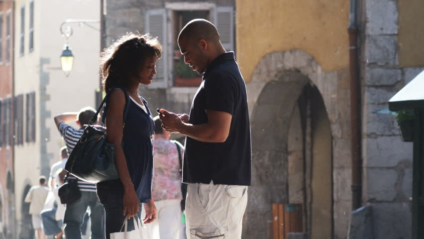Annecy-France - 06,30,2005: couple standing on a European street using a cell phone for directions | Shutterstock HD Video #12252629
