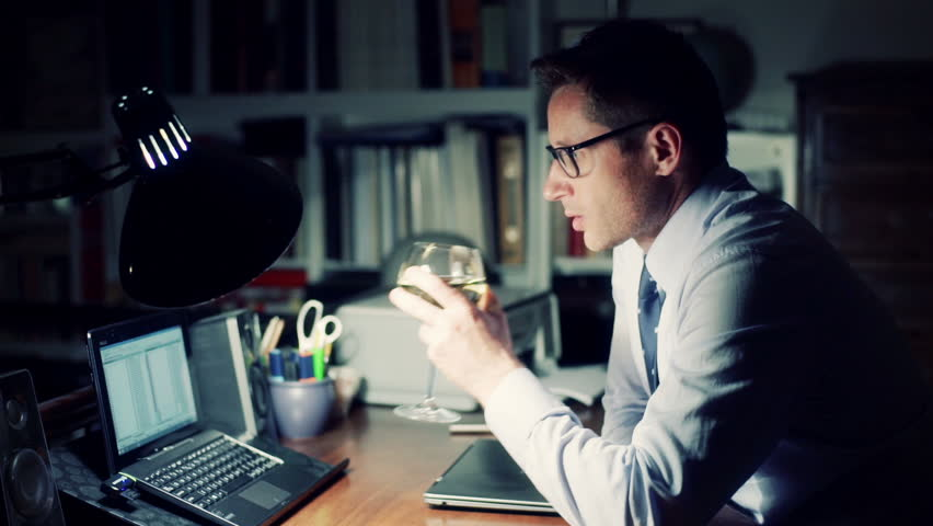Man working at night on laptop and drinking wine  | Shutterstock HD Video #12264683