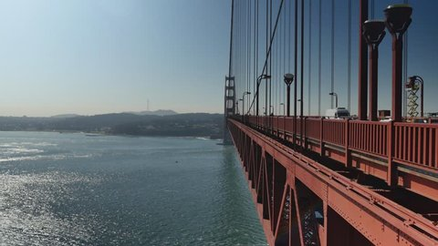SAN FRANCISCO, CA - Circa October, 2015 - A daytime establishing shot of the Golden Gate Bridge as as seen from the east side walkway.