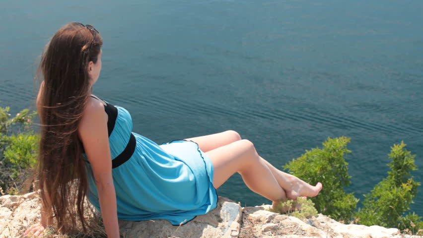 Young woman resting on top of a mountain near the Black Sea | Shutterstock HD Video #1226896