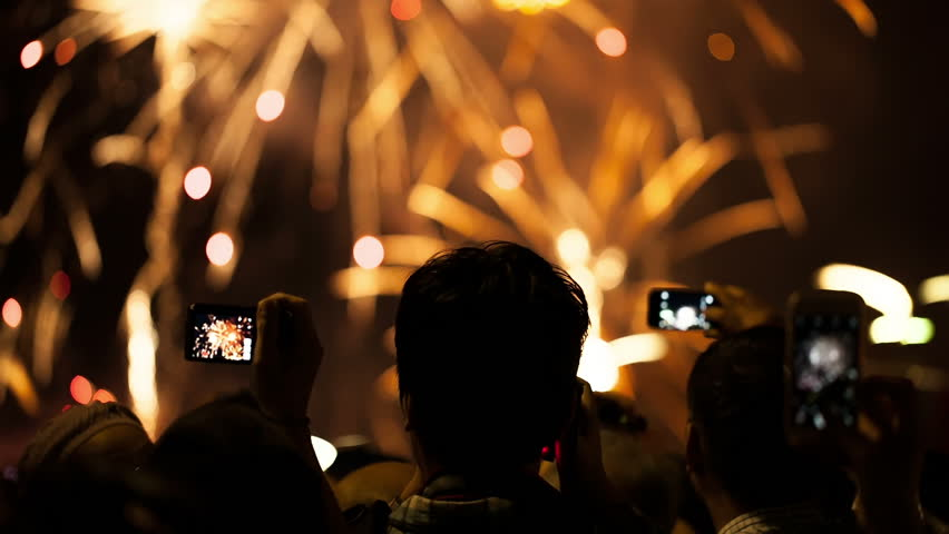 """Watching Fireworks silhouetted crowd. Holiday backgrounds. Fireworks in the sky celebrating lunar new year... >>> Please search more: """" FireworksCollection """". #12284807"""