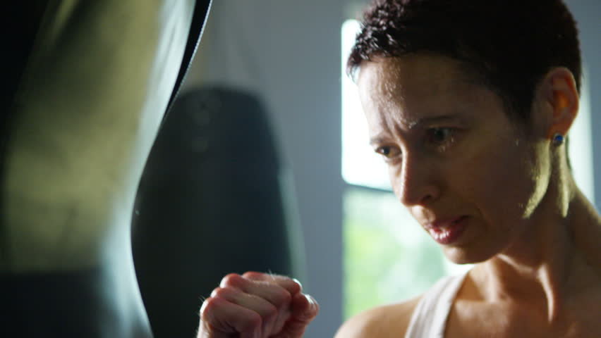 4K Female martial artist or boxer training with a punch bag at the gym. Shot on RED Epic. | Shutterstock HD Video #12287105