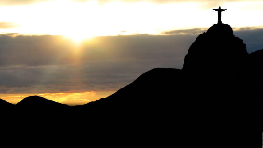 Rio de Janeiro, Sugarloaf with the statue of Christ, with the sunset in the background. | Shutterstock HD Video #1230196