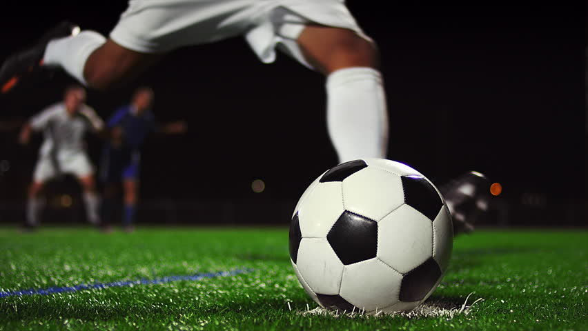 Close up of a soccer ball being kicked in slow motion at night   Shutterstock HD Video #12304745
