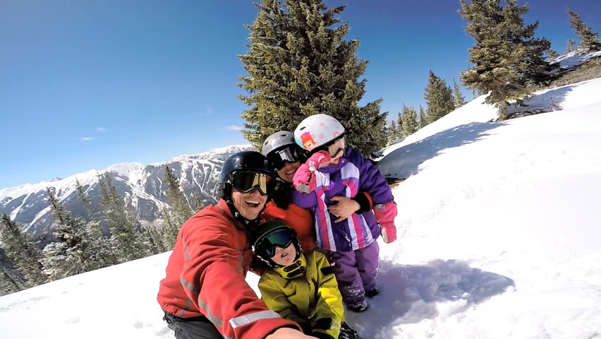 Selfie portrait social media Caucasian family parents son daughter childhood outdoor lifestyle tourism promotion snow snowboarding travel | Shutterstock HD Video #12332870