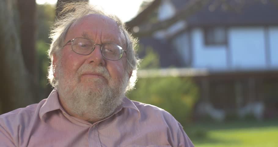Portrait of grandfather elderly retired senior man at retirement age outdoors | Shutterstock HD Video #12357332