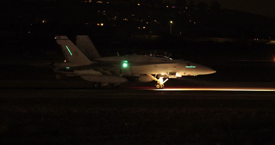 MIRAMAR, CA - OCT 3: An F/A-18 Super Hornet performs a night afterburner take-off at the Miramar Air Show in Miramar, CA on Oct 3, 2015. About 700,000 people attend the show annually.