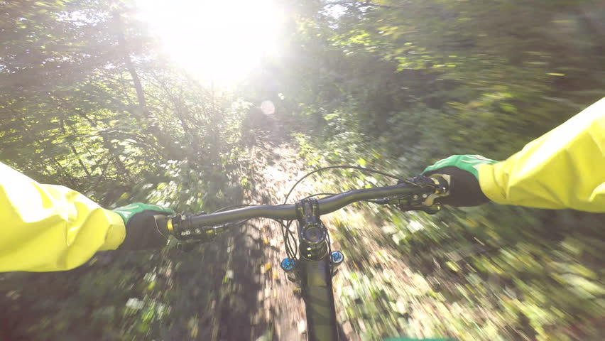 Mountain biker riding through the forest in fall | Shutterstock HD Video #12373589