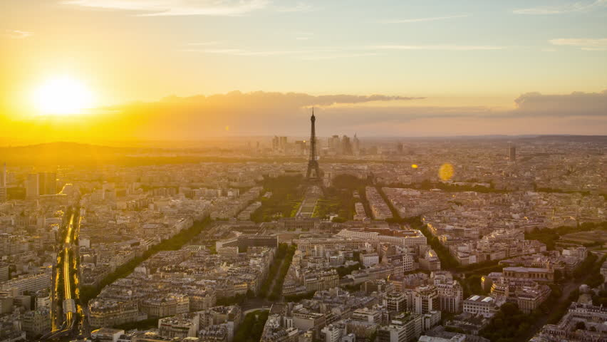 Day to night time lapse of sun setting over Paris skyline, seen from Tour Montparnasse 56, Paris, France | Shutterstock HD Video #12385142