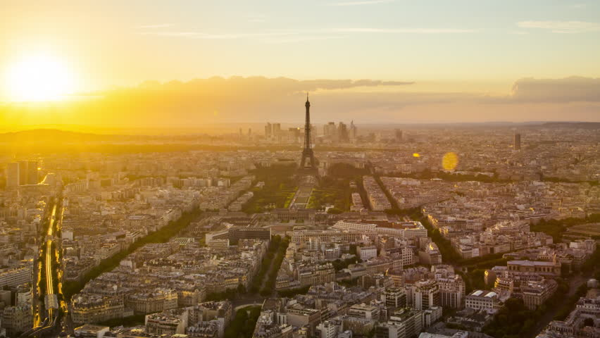 Day to night time lapse of sun setting over Paris skyline, seen from Tour Montparnasse 56, Paris, France   Shutterstock HD Video #12385145