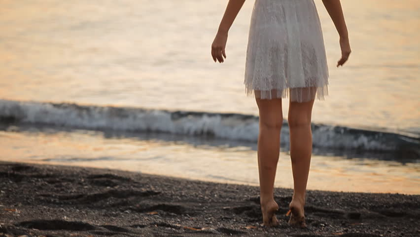 Girl goes to sunrise,Santorini island    Shutterstock HD Video #12387893