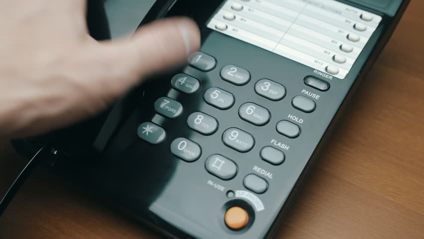 In the dim lights hand picks up the black (white) phone, dials a number and hangs up. Rotation | Shutterstock HD Video #12419081