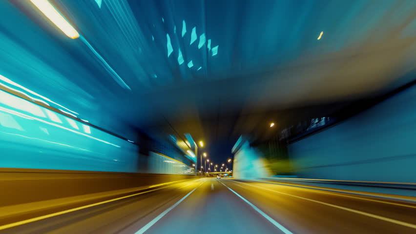 30p Driving pov modern highway timelapse/hyperlapse night, rapid speed, passing a series of tunnels.Camera outside the vehicle giving the illusion of teleporting through an series of turns,and tunnels | Shutterstock HD Video #12429302