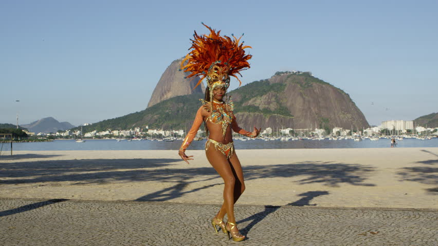 Samba dancing in full costume in Rio de Janiero beach