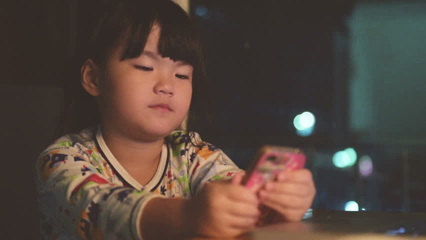 Cute girl using a mobile phone.