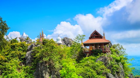Time lapse Unseen Wat Prajomklao Rachanusorn Amazing temple on top of mountain at Lampang, North of Thailand. (wat pra bath pu pha dang temple)