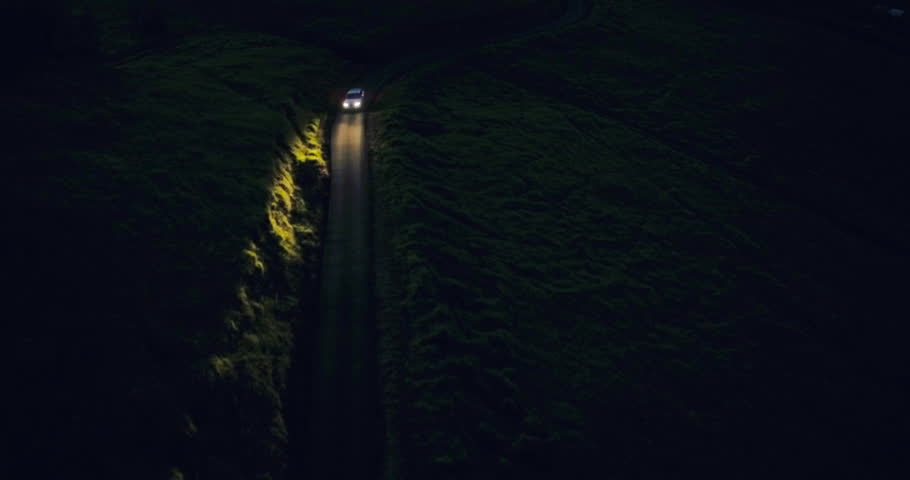 Aerial View Car Headlights Night Driving on Winding Country Road | Shutterstock HD Video #12502952