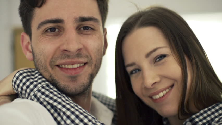 Portrait of happy, young couple hugging and turning around, slow motion 240fps  #12504107