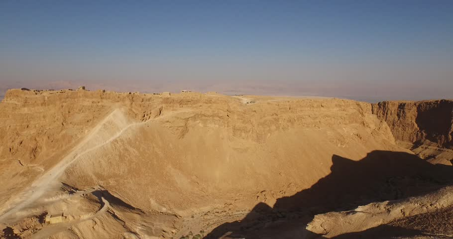 Soaring aerial 4K view MASADA, ISRAEL. Filmed flying the DJI Inspire drone. | Shutterstock HD Video #12509021
