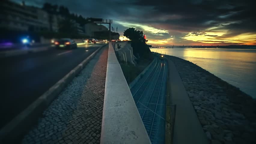 Cinemagraph Loop - Train moving under bridge with stormy sky - motion photo #12509993