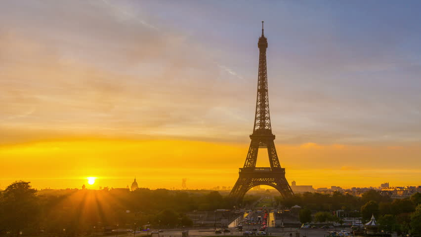 4K timelapse of Paris at sunrise with the Eiffel Tower at the Trocadero gardens. Zoom out pan.