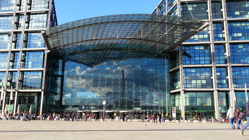 Crowd of people near large shopping mall. Modern concrete glass building, urban architecture. Tourists and citizens visiting sightseeing place, city infrastructure, berlin landmark facade, big store