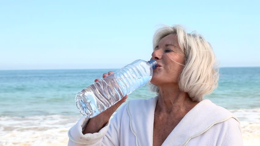 Senior Woman Drinking Water from Stock Footage Video (100% Royalty-free)  1252324   Shutterstock