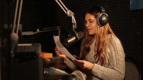 A radio DJ reads news in the broadcasting studio Russia