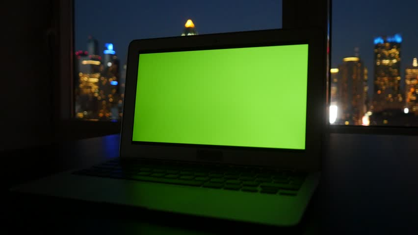 Laptop desk view in modern business office. city skyline background. computer screen  isolated with green screen | Shutterstock HD Video #12549491