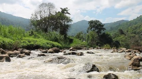 Whitewater flowing over rocks in small river at Maetang, Chiang Mai, Thailand