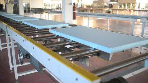 KHERSON, UKRAINE - OCTOBER 31, 2015: Plant conveyor manufacturing polyurethane foam insulation panel
