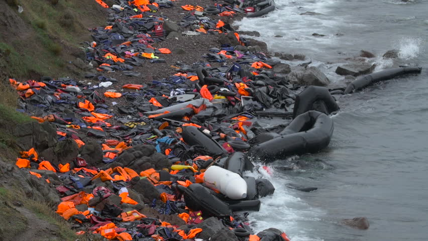Destroyed rafts and abandoned life jackets line the beaches of Lesbos, Greece as thousands of refugees pour into Europe.