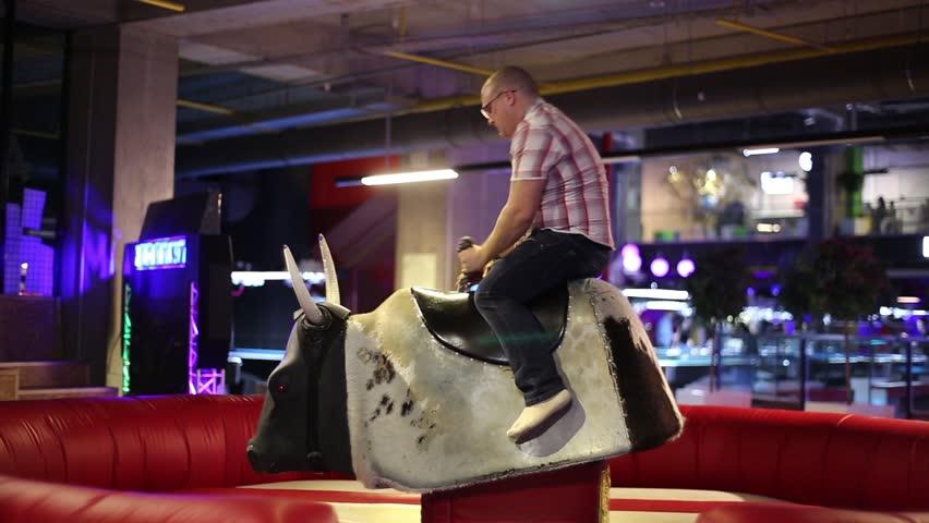 A man riding a bull
