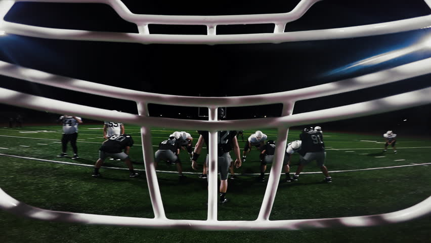 First person point of view from inside a football player's helmet, as the player makes a touchdown