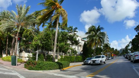MIAMI BEACH - NOVEMBER 3: Motion video of Ocean Drive which is located between 1st and 15th St and is lined with famous deco hotels and restaurants across from the beach November 3, 2015  Miami Beach