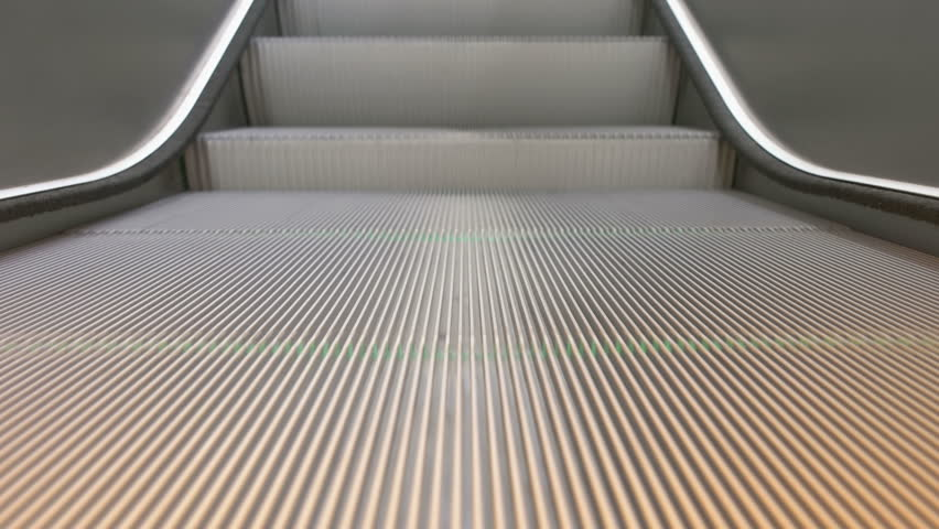 Detailed front focused shot of running escalator stairs | Shutterstock HD Video #12657473