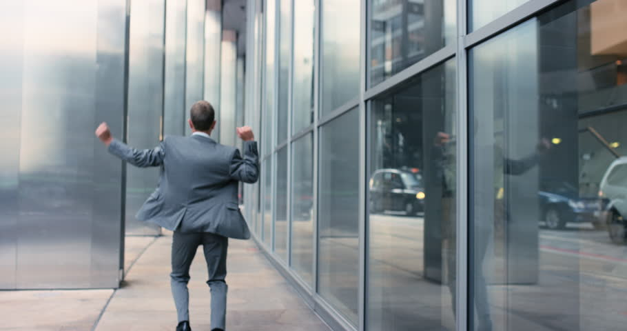 Businessman dancing rear view Contemporary happy funky caucasian street dancer freestyle in the city #12658349
