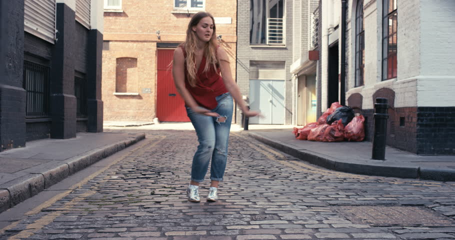 Contemporary street dancer woman happy funky urban dancing freestyle in the city | Shutterstock HD Video #12658481