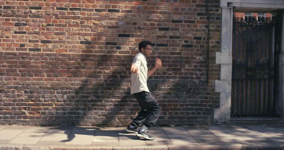 Hip-Hop happy mixed race dancer man funky street dancer dancing freestyle in the city #12658781