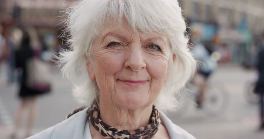 Slow Motion Portrait of happy mature old woman smiling in city real people series | Shutterstock HD Video #12659339