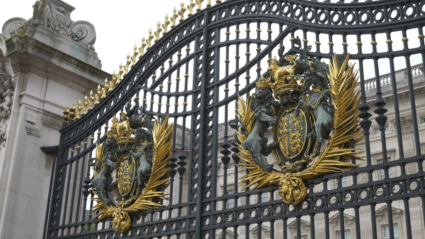 The front entrance of the Buckingham Palace. The shield is quartered, depicting in the first and fourth quarters the three passant guardant lions of England #12660887
