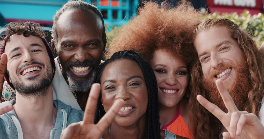 Slow Motion Portrait of happy multi ethnic group of people smiling in the city peace sign real people series