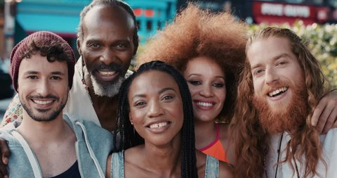 Slow Motion Portrait of happy multi ethnic group of people smiling in the city real people series