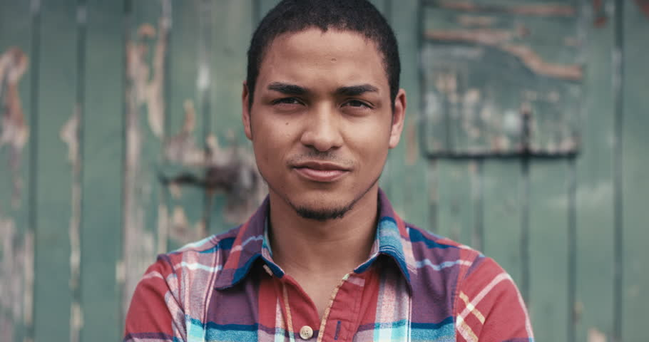 Slow Motion Portrait of mixed race man smiling urban face normal people series | Shutterstock HD Video #12666344