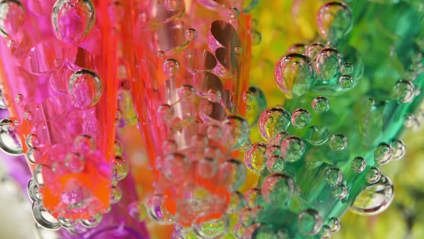 Soda water bubbles. Sparkling bubbles rising in a glass of clean water. Macro close-up 4K UHD 2160p footage. | Shutterstock HD Video #12669650