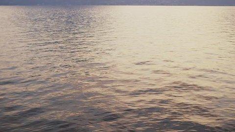 Glistening lake waves at sunset