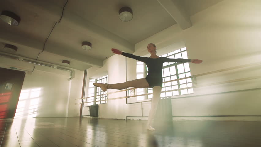 graceful girl practicing ballet in the Studio, slow motion , performs the elements of dance