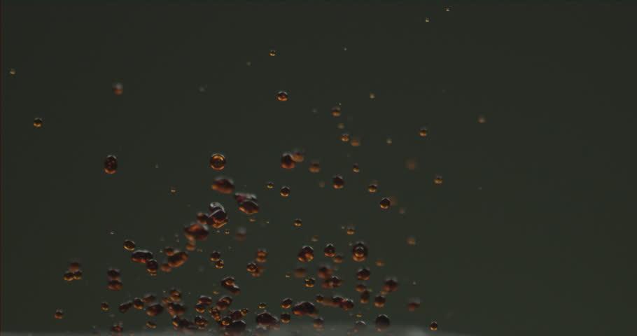 Coffee liquid vibrating on speaker