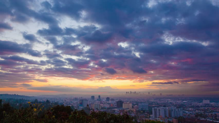 Sunrise over Los Angeles cityscape. Zoom in on downtown. 4K UHD Timelapse.