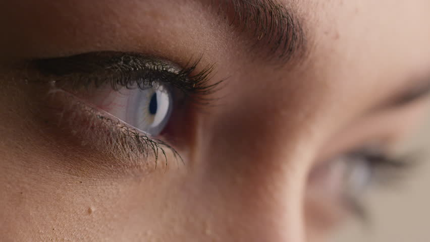 Close-up shot of woman blue eye with light day make-up. Shot on RED Cinema Camera in 4K (UHD).